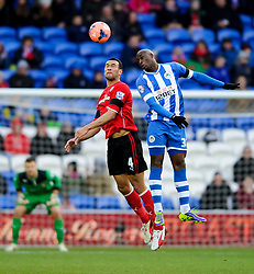 Cardiff Defender Steven Caulker (ENG) and Wigan Forward Marc-Antoine Fortune (FRA) compete in the air - Photo mandatory by-line: Rogan Thomson/JMP - 07966 386802 - 15/02/2014 - SPORT - FOOTBALL - Cardiff City Stadium - Cardiff City v Wigan Athletic - The FA Cup Fifth Round Proper.