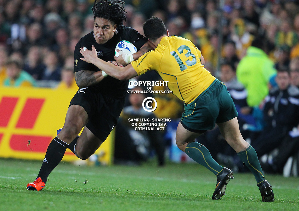 AUCKLAND, NEW ZEALAND - OCTOBER 16, Anthony Faingaa looks to make a tackle on Ma'a Nonu during the 2011 IRB Rugby World Cup Semi Final match between New Zealand and Australia at Eden Park on October 16, 2011 in Auckland, New Zealand<br /> Photo by Steve Haag / Gallo Images