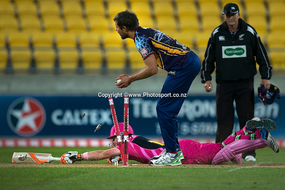 Tim Seifert (Bottom) of the Knights slides in to safety as Sam Wells of the Volts takes off the bails during the Georgie Pie Super Smash Volts v Knights cricket match at the Westpac Stadium in Wellington on Sunday the 23rd of November 2014. Photo by Marty Melville/www.Photosport.co.nz