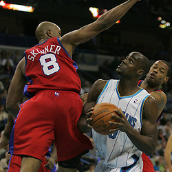 Jan 13, 2010; New Orleans, LA, USA; New Orleans Hornets center Emeka Okafor (50) is defended by Los Angeles Clippers center Brian Skinner (8) during the second half at the New Orleans Arena. The Hornets defeated the Clippers 108-94. Mandatory Credit: Derick E. Hingle-US PRESSWIRE