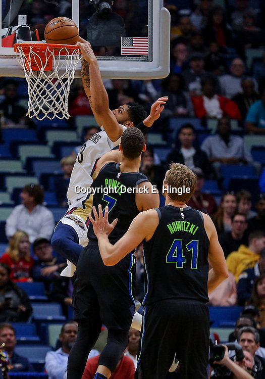 Mar 20, 2018; New Orleans, LA, USA; New Orleans Pelicans forward Anthony Davis (23) dunks over Dallas Mavericks center Dwight Powell (7) and center Dirk Nowitzki (41) during the first quarter at the Smoothie King Center. Mandatory Credit: Derick E. Hingle-USA TODAY Sports