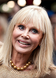© Licensed to London News Pictures. 24/09/2012. LONDON, UK. Bond girl Britt Ekland, who played Bond Girl 'Goodnight' in 'The Man with the Golden Gun' is seen outside HMV in Oxford Street, London, today (24/09/12) during a photocall. The stars were in London during the final leg of a UK tour to promote the Bond 50 Blu-Ray collection.  Photo credit: Matt Cetti-Roberts/LNP