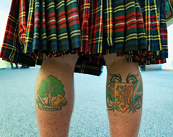 Edinburgh, Scotland, UK. 27 April, 2019. SNP ( Scottish National Party) Spring Conference takes place at the EICC ( Edinburgh International Conference Centre) in Edinburgh. Pictured Detail of tattoos on legs of Steve Davis an avid SNP supporter from Wales supporting Nicola's Army