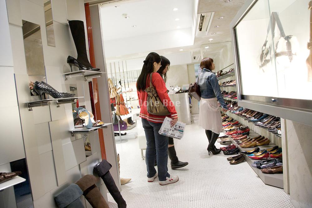 girls shopping for shoes Tokyo Japan