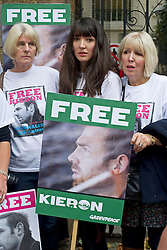 © London News Pictures. 05/10/2013.  London, UK. Nancy Thorburn (centre), girlfriend of imprisoned Greenpeace journalist  Kieron Bryan holding a picture of her boyfriend. Supporters of Greenpeace stage a demonstration outside the Russian Embassy in London to protest against the arrest of 30 Greenpeace activists, known as the 'Arctic 30' who charged with piracy by a Russian court, following a peaceful protest against Arctic oil drilling at an oil platform in the Pechora Sea. Photo credit Ben Cawthra/LNP