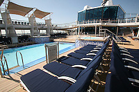 Celebrity Eclipse interior photos..Deckchairs by the pool