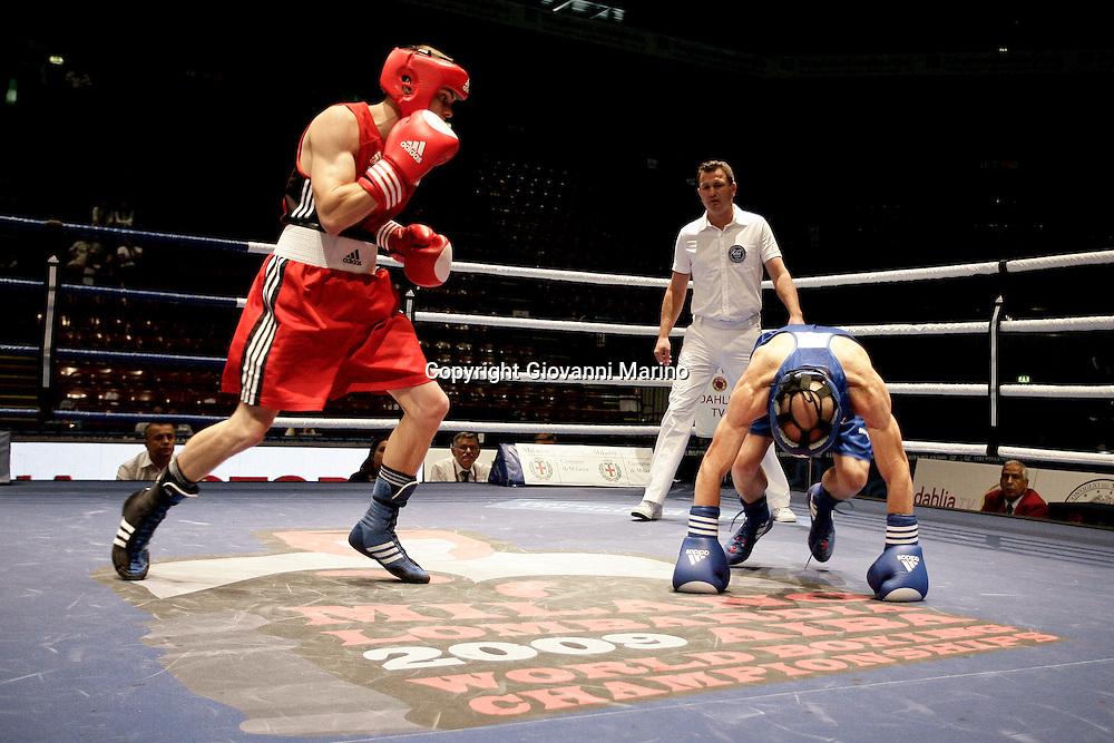 Milan, 08-09-2009 ITALY - Aiba World Boxing Championship Milan 2009.   Fly 51kg preliminaries..Pictured: Beblik Ronny GER red vs AleksandrovAleksander BUL blue.Photo by Giovanni Marino/OTNPhotos . Obligatory Credit