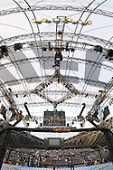 """ABU DHABI, UNITED ARAB EMIRATES, APRIL 10, 2010: A composite vertical panoramic view of the octagon and cage cover at """"UFC 112: Invincible"""" inside Ferari World, Abu Dhabi on April 10, 2010"""