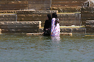 Women in Islamic attire wade in pond below the World's Fair Pavilion in Forest Park; St. Louis, Missouri.