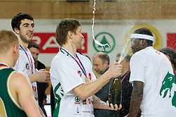 Vladimer Boisa  and Kevinn Pinkney of Union Olimpija celebrate with a champign  after winning the basketball match between KK Helios Domzale and KK Union Olimpija in Final of Spar Slovenian Cup, on February 13, 2011 in Sportna dvorana Poden, Skofja Loka, Slovenia. Union Olimpija defeated Helios 92-55 and become Slovenian Cup Champion. (Photo By Vid Ponikvar / Sportida.com)