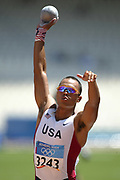Bryan Clay of the United States competes in the Decathlon shot put competition in the 2004 Olympics in Athens, Greece on Monday, August 23, 2004. Clay finished second overall with 8,820 points.