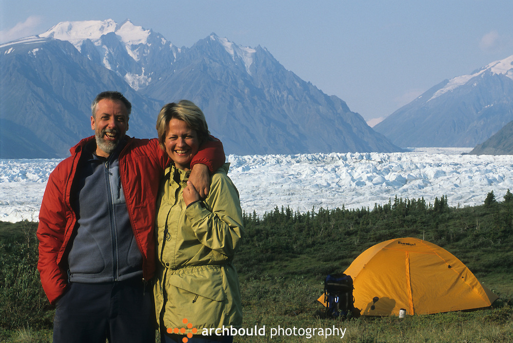A couple pose in front of the Donjek Glacier, Yukon