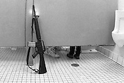 Mancos,Co-- A father and son take a restroom break after lookinf at guns at a gun show being held at the    Manco's High School  cafeteria  on Saturday and Sunday, August 14-15,1999,  Phot by Essdras M Suarez