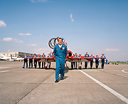 Engineering ground staff of the Red Arrows, Britain's RAF aerobatic team push a BAE Systems Hawk jet into position.