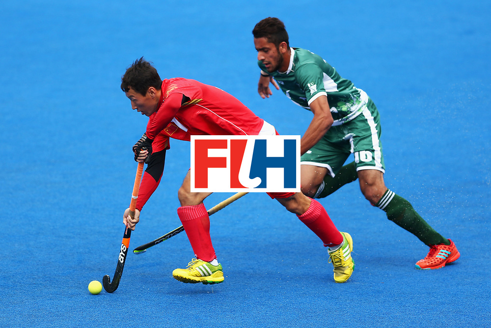 LONDON, ENGLAND - JUNE 25:  Weibao Ao of China and Ammad Shakeel of Pakistan battle for possession during the 7th/8th place match between Pakistan and China on day nine of the Hero Hockey World League Semi-Final at Lee Valley Hockey and Tennis Centre on June 25, 2017 in London, England.  (Photo by Steve Bardens/Getty Images)
