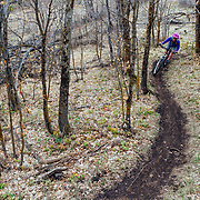 Heather Goodrich rides spring singletrack through a mini forest eco-system in Pocatello Idaho.