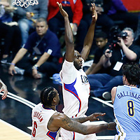 26 December 2016: Denver Nuggets forward Danilo Gallinari (8) passes the ball around LA Clippers forward Luc Mbah a Moute (12) and LA Clippers center DeAndre Jordan (6) during the Denver Nuggets 106-102 victory over the LA Clippers, at the Staples Center, Los Angeles, California, USA.