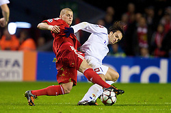 LIVERPOOL, ENGLAND - Wednesday, December 9, 2009: Liverpool's Martin Skrtel and AFC Fiorentina's Alberto Gilardino during the UEFA Champions League Group E match at Anfield. (Photo by David Rawcliffe/Propaganda)