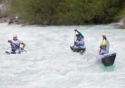 (L-R) Blaz Cof, Peter Znidarsic and Simon Hocevar of Slovenia compete in 3 x C1 men at sprint teams race at European wildwater Canoeing Championships Soca 2013 on May 12, 2013 in Trnovo ob Soci, Soca river, Slovenia. (Photo By Vid Ponikvar / Sportida)