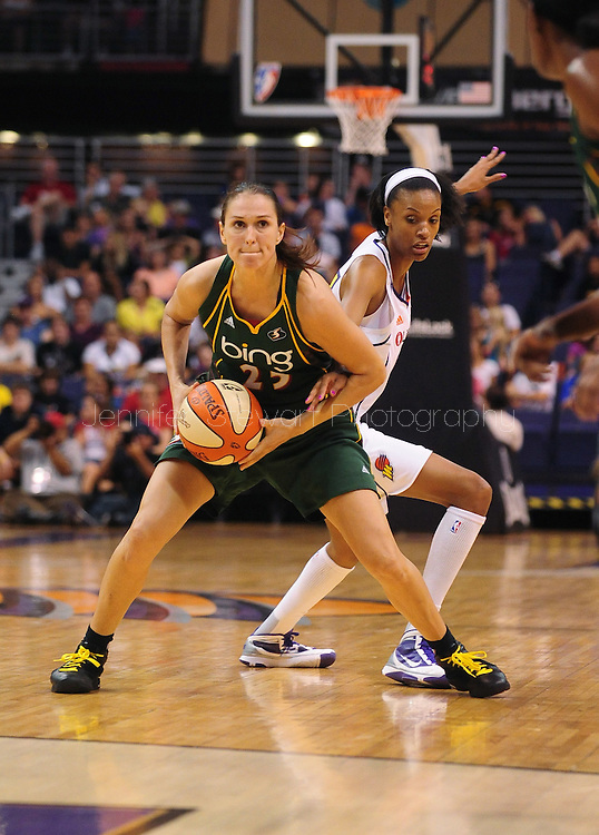 Aug 20, 2010; Phoenix, AZ, USA; Seattle Storm forward Svetlana Abrosimova handles the ball against Phoenix Mercury guard DeWanna Bonner during the second half in at US Airways Center.  The Storm defeated the Mercury 78-73.  Mandatory Credit: Jennifer Stewart-US PRESSWIRE