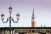 Gondola sign and San Giorgio Maggiore bell tower, Piazza San Marco (St. Mark's Square), Venice, Veneto, Italy
