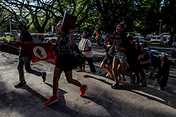 April 13, 2018 - Quezon City, Philippines - Students in black protest against Philippines President Rodrigo Duterte's violation of human rights and dictatorship at the University of the Philippines in Quezon City on Friday. The protesters, gathered from different colleges, brought flags and a coffin to symbolize the death of democracy and human rights under the Duterte administration. (Credit Image: © Basilio H. Sepe via ZUMA Wire)