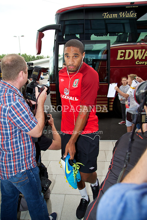 NEWPORT, WALES - Monday, August 12, 2013: Wales' captain Ashley Williams runs the gauntlet of photographers as he arrives for training at the FAW National Development Centre at Dragon Park ahead of the International friendly against the Republic of Ireland. (Pic by David Rawcliffe/Propaganda)