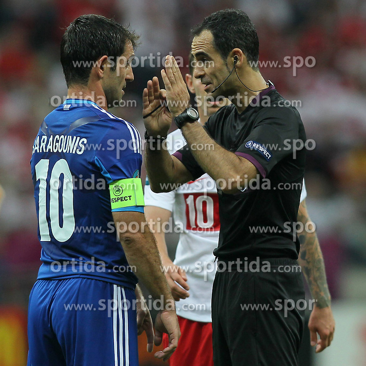 08.06.2012, Nationalstadion, Warschau, POL, UEFA EURO 2012, Polen vs Griechenland, Gruppe A, im Bild GIORGOS KARAGOUNIS (L) CARLOS VELASCO CARBALLO (P) // during the UEFA Euro 2012 Group A Match between Poland and Greece at the National Stadium Warsaw, Poland on 2012/06/08. EXPA Pictures © 2012, PhotoCredit: EXPA/ Newspix/ Mateusz Trzuskowski..***** ATTENTION - for AUT, SLO, CRO, SRB, SUI and SWE only *****