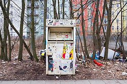 Isolated second hand clothes collection point in Berlin , Germany