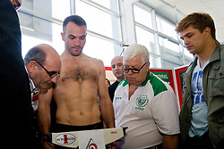 Slovenian Boxer Dejan Zavec alias Jan Zaveck alias Mr. Simpatikus and his coach Dirk Dzemski (R) at official weighing before defending the title of IBF World Champion, on April 8, 2010, in Avto Delta, Ljubljana, Slovenia.  (Photo by Vid Ponikvar / Sportida)