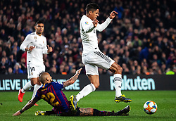 BARCELONA, Feb. 7, 2019  Real Madrid's Raphael Varane (R) competes with FC Barcelona's Arturo Vidal (bottom) during the Spanish King's Cup semifinal first leg match between FC Barcelona and Real Madrid in Barcelona, Spain, on Feb. 6, 2019. The match ended with a 1-1 draw. (Credit Image: © Joan Gosa/Xinhua via ZUMA Wire)
