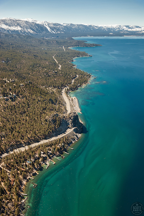"""Lake Tahoe Aerial 6"" - Aerial photograph of Lake Tahoe's East shore shot from a helicopter with the door removed. Cave Rock can be seen in the center of the photo."
