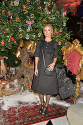 LAURA BAILEY at a party to celebrate the unveiling of the 2014 Claridge's Christmas tree by Dolce & Gabbana at Claridge's, Brook Street, London on 19th November 2014.