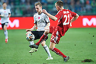 (L) Legia's Ondrej Duda fights for the ball with (R) Wisla's Lukasz Burliga during T-Mobile ExtraLeague soccer match between Legia Warsaw and Wisla Krakow in Warsaw, Poland.<br /> <br /> Poland, Warsaw, March 15, 2015<br /> <br /> Picture also available in RAW (NEF) or TIFF format on special request.<br /> <br /> For editorial use only. Any commercial or promotional use requires permission.<br /> <br /> Mandatory credit:<br /> Photo by © Adam Nurkiewicz / Mediasport