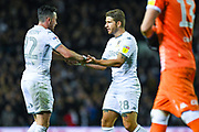 Leeds United midfielder Jack Harrison (22) and Leeds United defender Gaetano Berardi (28) after winning 1-0 during the EFL Sky Bet Championship match between Leeds United and West Bromwich Albion at Elland Road, Leeds, England on 1 October 2019.