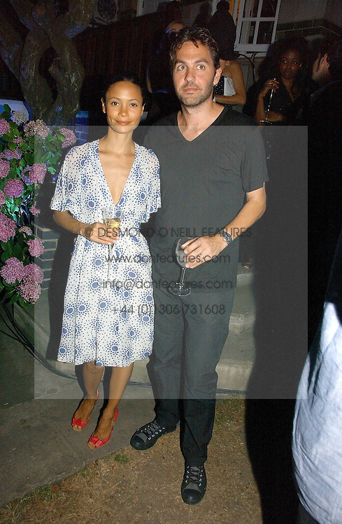 Actress THANDIE NEWTON and her husband OLIVER PARKER at a party to celebrate FilmFour becoming the UK's first major free film channel held at Debenham House, Addison Road, London on 20th July 2006.<br /><br />NON EXCLUSIVE - WORLD RIGHTS