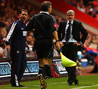 Photo. Daniel Hambury.<br />The Barclays Premiership.<br />Charlton Athletic V Blackburn Rovers. 27/09/2004.<br />Blackburn Rovers' manager Mark Hughes and assistant speak with the linesman