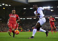 Yannick Bolasie of Crystal Palace (right) crosses as Nathaniel Clyne of Liverpool (left) closes down during the Barclays Premier League match at Anfield, Liverpool<br /> Picture by Russell Hart/Focus Images Ltd 07791 688 420<br /> 08/11/2015