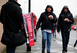 Match day half and half scarves for sale outside the ground
