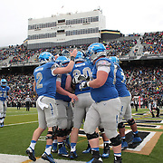 Garret Griffin, Air Force, is congratulated by teammates after scoring the second of his two touchdowns, during the Army Black Knights Vs Air Force Falcons, College Football match at Michie Stadium, West Point. New York. Air Force won the game 23-6. West Point, New York, USA. 1st November 2014. Photo Tim Clayton