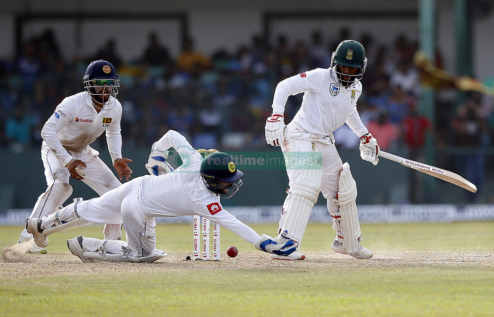 July 22, 2018 - Colombo, Sri Lanka - South African cricketer Temba Bavuma (4L) looks on as Sri Lankan wicket keeper Niroshan Dickwella (L) misses a catch during the 3rd day's play in the 2nd test cricket match between Sri Lanka and South Africa at SSC International Cricket ground, Colombo, Sri Lanka on Sunday  22 July 2018  (Credit Image: © Tharaka Basnayaka/NurPhoto via ZUMA Press)