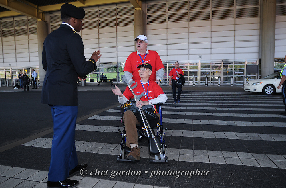 WWII Veterans and their escorts onboard the Hudson Valley Honor Flight arrive at Reagan National Airport in Arlington, VA on Saturday, April 11, 2015. Nearly 100 Veterans from the Orange County (NY) region toured the WWII, Korean, Vietnam, and USMC War Memorials, as well as Arlington National Cemetery. Hudson Valley Honor Flight is a chapter of the Honor Flight Network, which provides free flights for WWII Veterans and tours of the WWII Memorial constructed in their honor, and other sites in the nation's capital.  © Chet Gordon for Hudson Valley Honor Flight