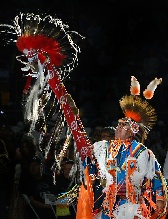 jt042817a/a sec/jim thompson/ Terrance Goodwill of Saskatchewan, Canada carries the Eagle Staff for the Grand Entrance of the 2017 Gathering of Nations Pow-Pow held at Tingley Coliseum.   Friday April 28, 2017. (Jim Thompson/Albuquerque Journal)
