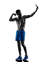 one caucasian man exercising fitness exercises pround selfie in studio silhouette isolated on white background