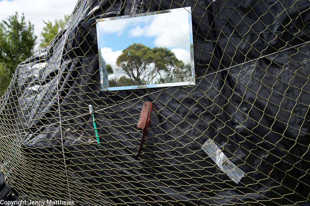 The Jungle, Centre for migrants Calais. A shelter with shaving mirror, toothbrush and comb.