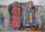 Two figures with haloes, possibly a saint standing on the body of a chained devil, fresco in the nave of the Church of St Spiridon, 18th - 19th centuries, completed 1864, in the Gorica quarter of Berat, South-Central Albania, capital of the District of Berat and the County of Berat. The church is a 3-nave basilica with two lower side naves and a bell tower. Picture by Manuel Cohen