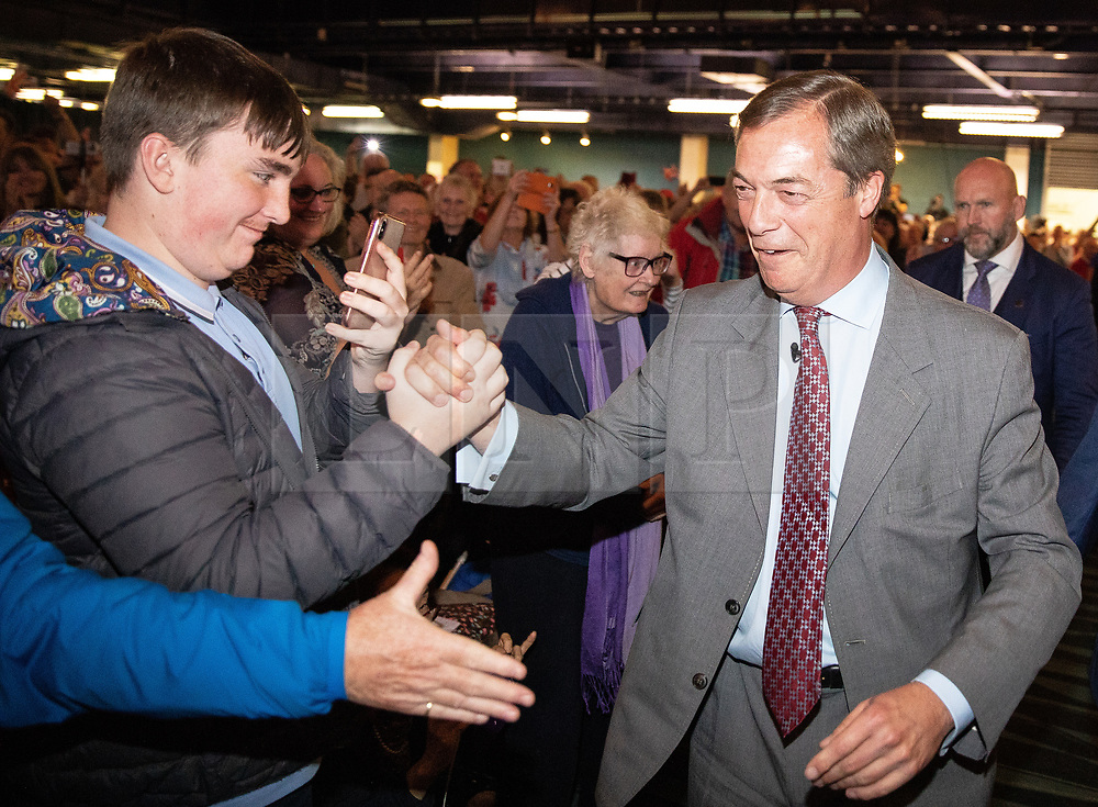 "© Licensed to London News Pictures . 22/09/2018. Bolton, UK. NIGEL FARAGE enters the auditorium to speak . Pro Brexit campaign group Leave Means Leave host a "" Save Brexit "" and "" Chuck Chequers "" rally at the University of Bolton Stadium , attended by leave-supporting politicians from a cross section of parties , including Conservative David Davis , former UKIP leader Nigel Farage and Labour's Kate Hoey . Photo credit: Joel Goodman/LNP"
