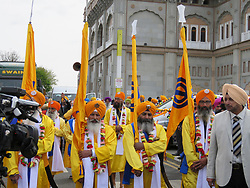 © London News Pictures. 15/04/2017. Gravesend, UK. Thousands of Sikh take part in a parade through the streets of Gravesend in Kent to celebrate the festival of Vaisakhi. The event, which  marks the Sikh New Year and commemorates the formation of Khalsa panth of warriors under Guru Gobind Singh in 1699. The four Photo credit: Graham Long/LNP