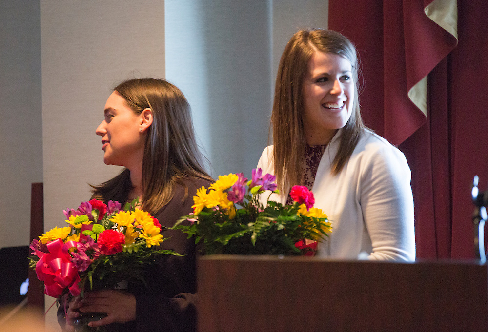 Class Presidents Elisabeth Rosenfeld, left, and Kelley Johnson, right, are presented with flowers at the Ohio University College of Business Commencement reception at The Ohio University Inn on April 9, 2016 (Photo by Emily Matthews)