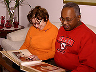 Roberta and Kenneth Screven, look at their wedding album (from December 24, 1966) on Saturday, January 27, 2007.